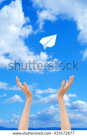Women's hands and blue sky