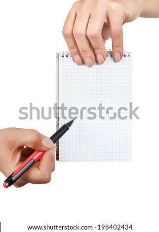 Women's hands are holding a Notepad in a cage and pen
