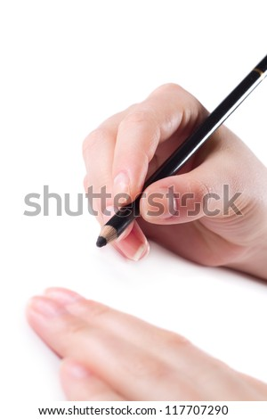 Women's hands are holding a pencil. Isolated on white background