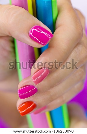 Women's hands hold a large colorful candy - stock photo
