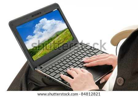 women's hands on laptop keyboard. image on the screen made ??by me