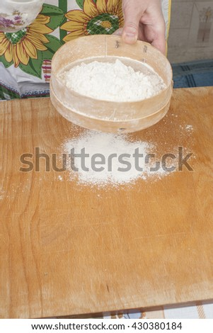 Women's hands preparing flour before baking pie