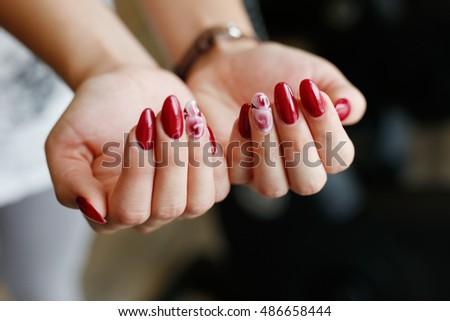 Women's hands with beauty profesional manicure with shallow focus