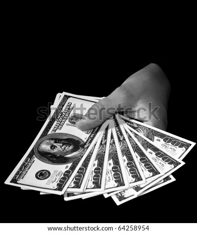 women's hands with packs of dollars over black