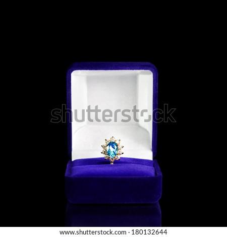 Women's jewelry on black background - stock photo