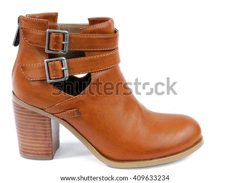 Women's leather booties with high heels photographed on white background.