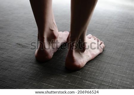 Women's legs, feet - stock photo