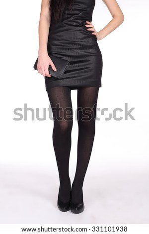women's legs in pantyhose and high heels - stock photo