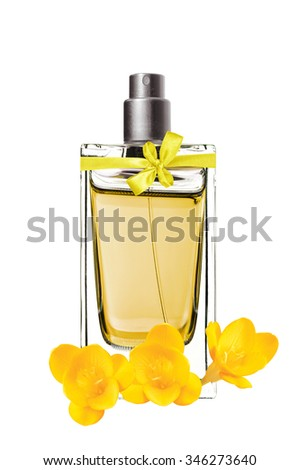 women's perfume in beautiful bottle and freesia flower isolated on white - stock photo