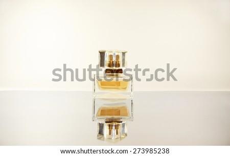 women's perfume on the mirror surface - stock photo
