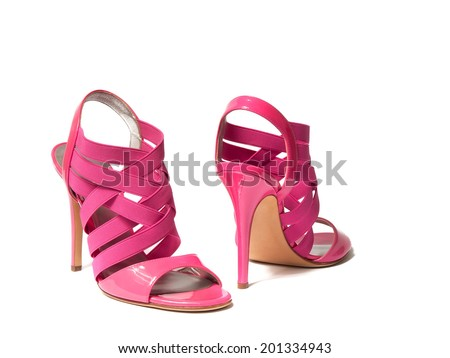 Women's pink high-heeled shoes on white background