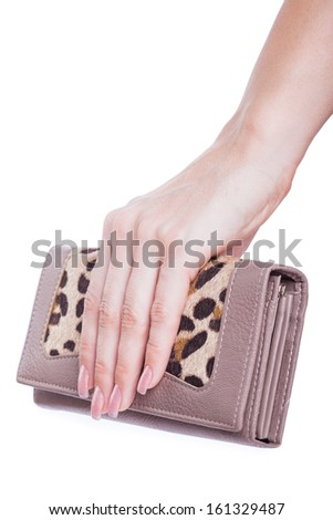 Women's purse in hand isolated on white