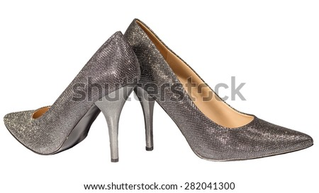 Women's silver stilettos isolated white background - stock photo