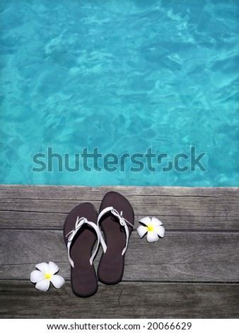 women sandals on  wooden floor with flowers near the water, summer, vacation, spa - stock photo