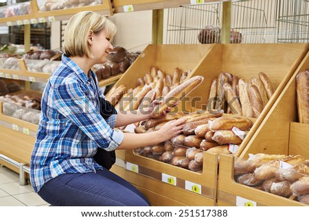 Women shopping bread in supermarket - stock photo