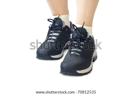 Women sports shoes / sneakers. Closeup of woman legs and feet wearing shoes. Isolated on white background. - stock photo