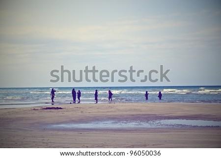 WOMEN TAKING BATH INTO INDIAN SEA - stock photo