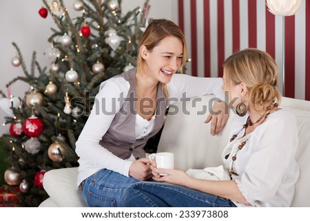 women talking and drinking coffee on christmas day - stock photo