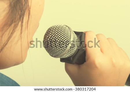 women talking with microphone to someone