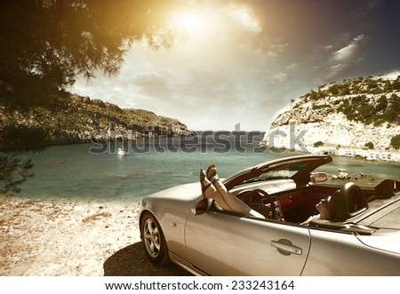 Women traveling in a convertible on Resorts  - stock photo