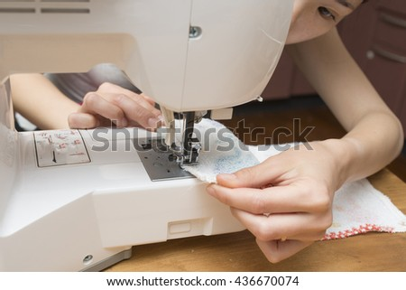 Women use a sewing machine