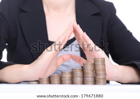 Women use hands for cover her money with safe moeny to invest something - stock photo