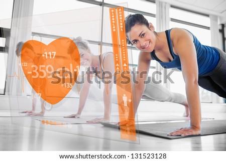 Women using modern orange interface at the gym - stock photo