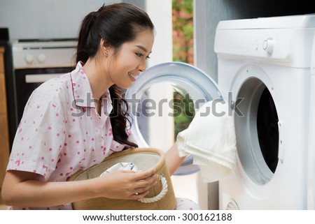 Women washing clothes The washing machine