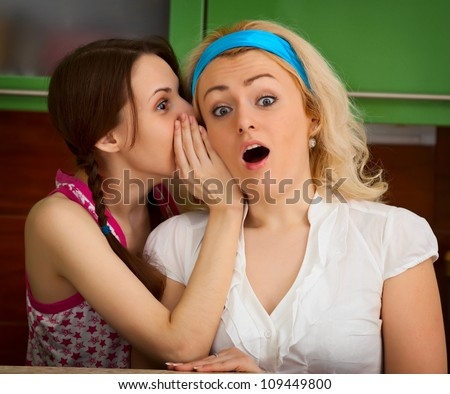 Women whisper secret shock amazing news. Pair of person telling on kitchen.