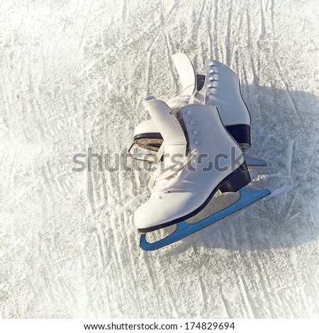 Women white skates. Abstract background on a winter sports theme. - stock photo