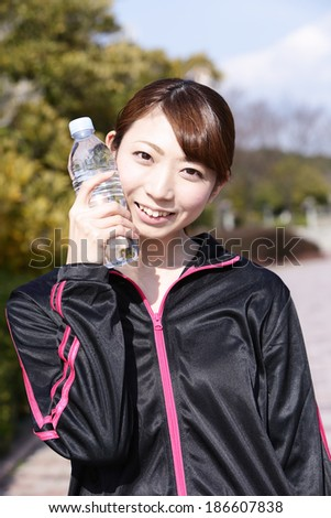 Women who are training in the park - stock photo