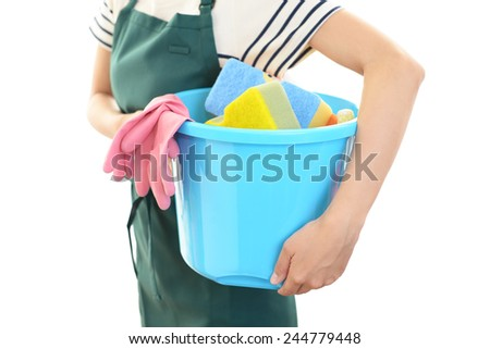 Women with a cleaning tool