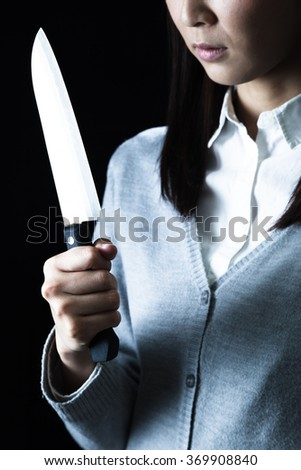 Women with a kitchen knife, Insanity - stock photo