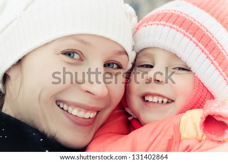 Women with baby in winter - stock photo