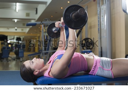 Women with barbells in gym