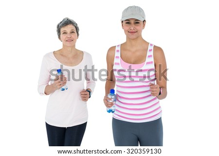 Women with bottle jogging against white background - stock photo