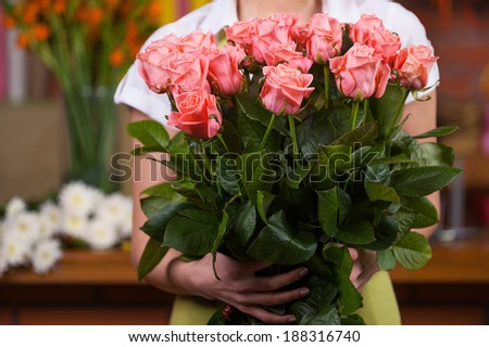 Women with bunch of roses. Cropped image of woman holding bunch of roses  - stock photo