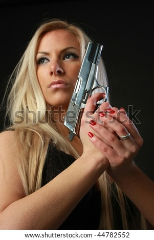Women with gun in hand
