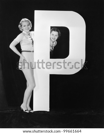 Women with huge letter P - stock photo
