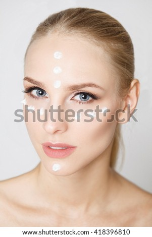 women with moisturizing cream on the face. Perfect skin. Care - stock photo