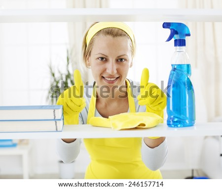 Women with thumbs up gesturing excellent work - stock photo
