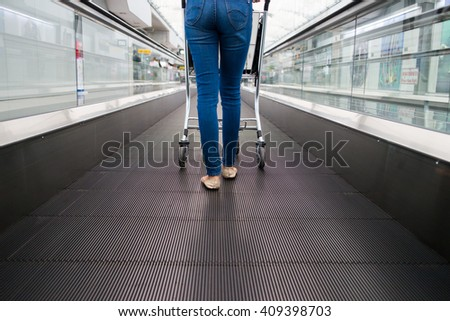 women with trolley at the airport walkway