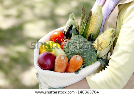 Women with vegetables harvested - stock photo