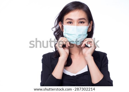 Women wore a germ mask on a white background. - stock photo