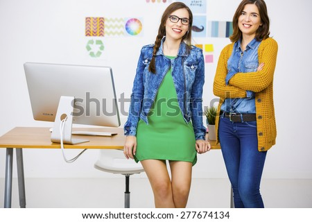 Women working at desk In a creative office, team work  - stock photo