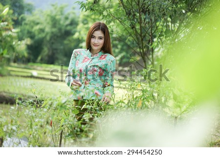 women working in her vegetable garden