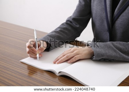 Women writing in the notebook - stock photo