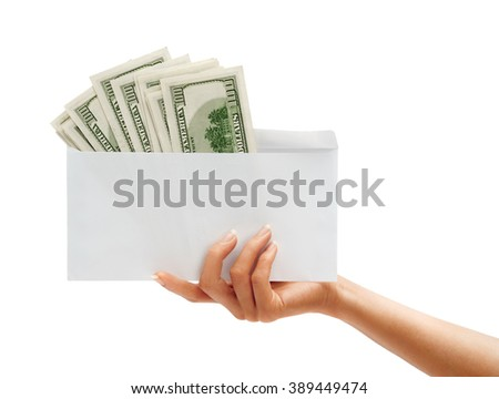 Womens Hand passes the envelope with dollars isolated on white background. Business concept - stock photo