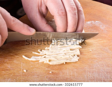 Womens hands in a process of preparing of dough for lagman.