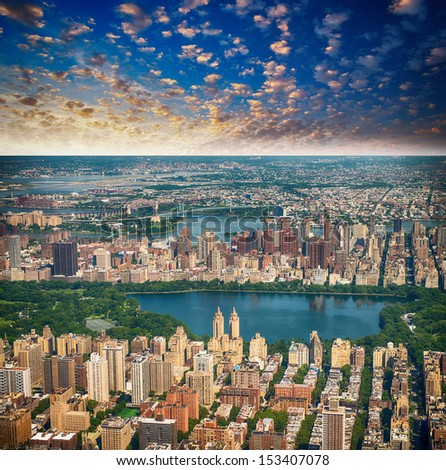 Wonderful aerial view of Central Park, Jacqueline Kennedy Onassis Reservoir and surrounding Manhattan  Skyscrapers, New York City. - stock photo